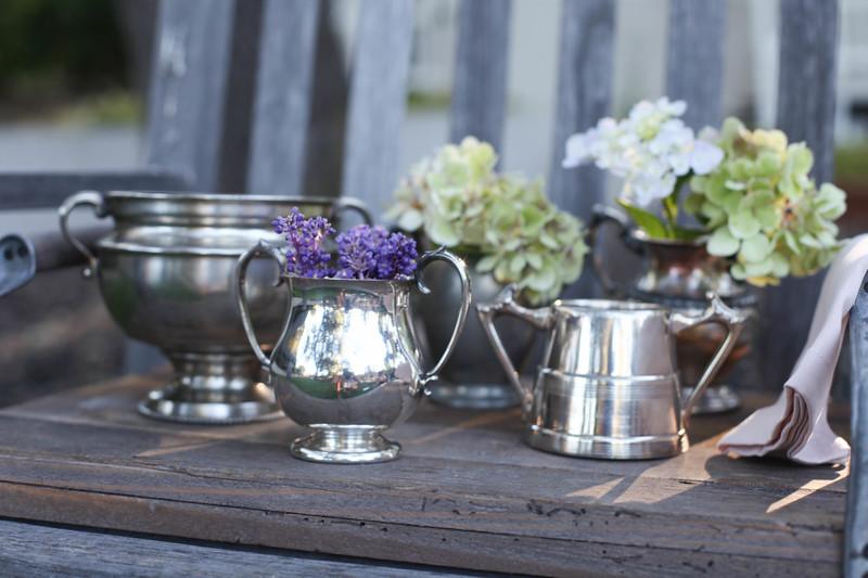 Small silver flower vessels