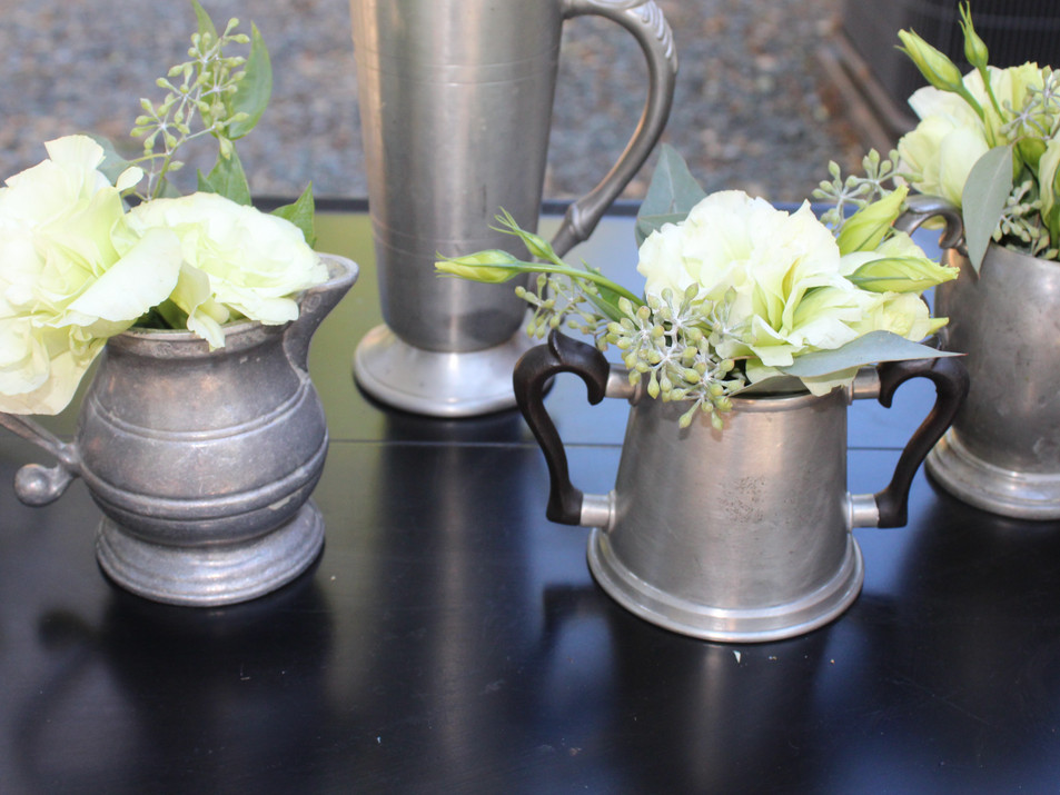 Small pewter flower vessels