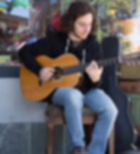 Max Mondzac playing guitar.