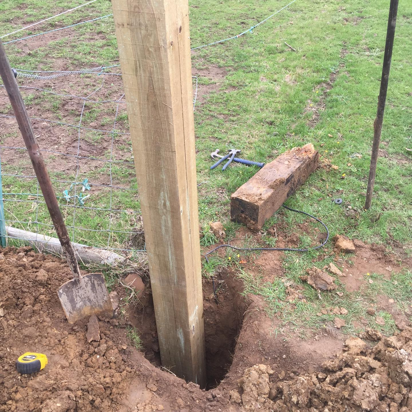Digging out and replacing gate posts
