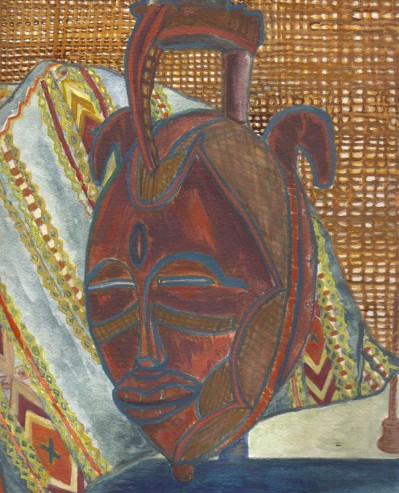 west african mask and straw