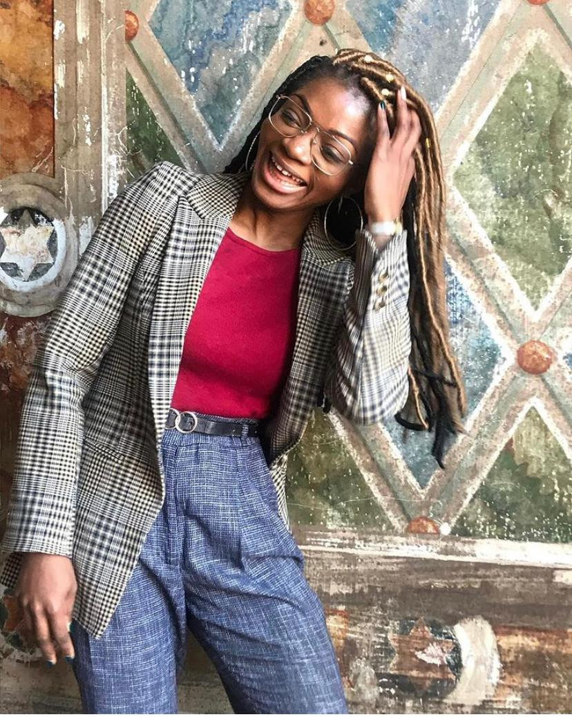 Esther Ajose founder of Outtakes Truth Uncut a Instagram podcast about normalizing uncomfortable conversations on race, justice, society, and more.