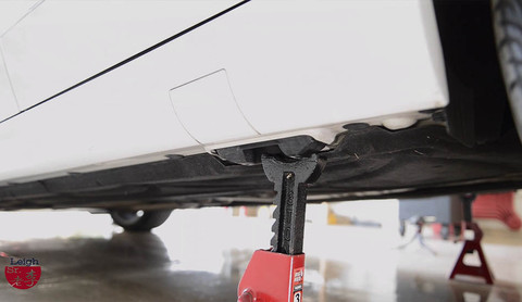 Support the rear of vehicle by jack stands