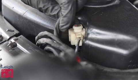 Remove the electric connecter of the headlamp washer pump