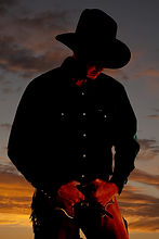 bigstock-Cowboy-In-Sunset-Looking-Down-2