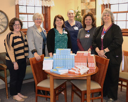 Hospice Staff with Books