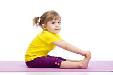 Child girl doing gymnastic exercises.jpg