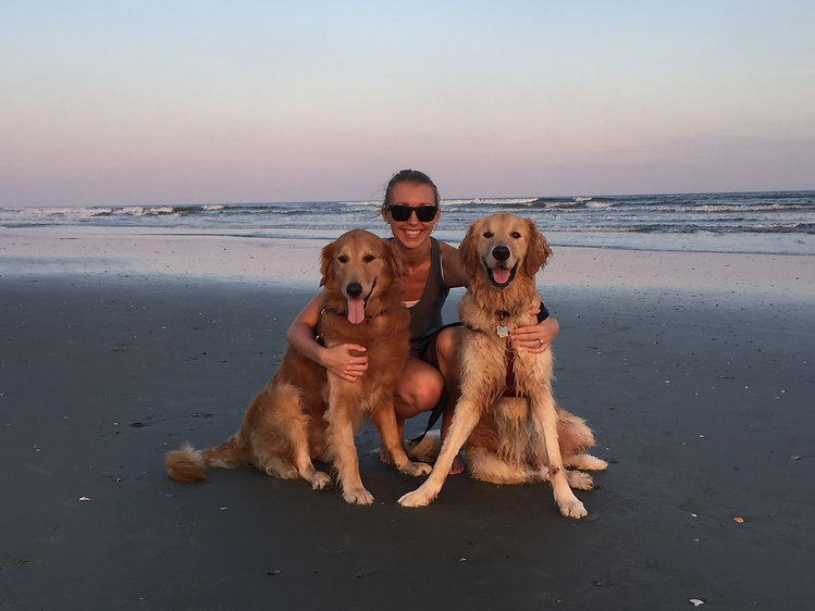 Woman with 2 Goldens at beach