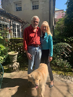 Couple with their recently adopted Golden