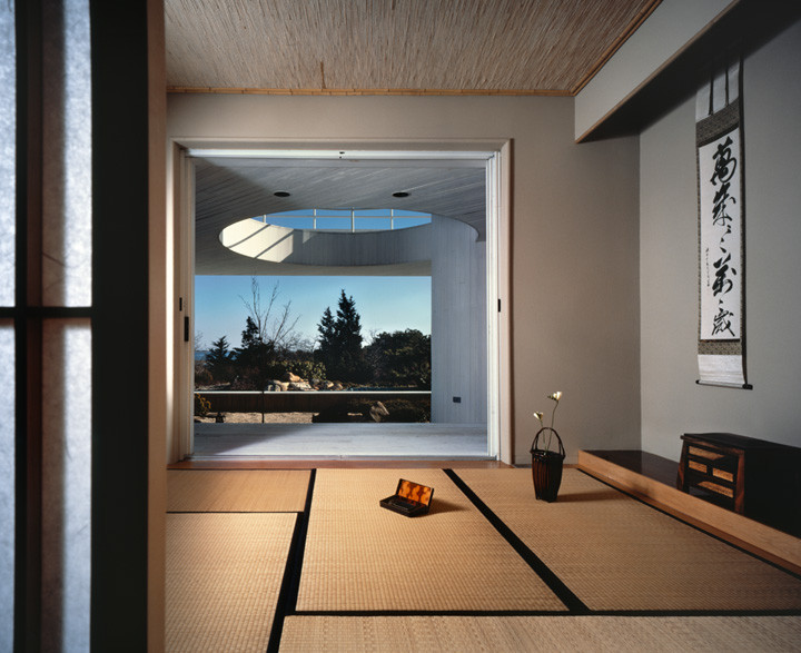 The Tatami Room opens to a tranquil outdoor space, creating a seamless transition between the meditation room and the serene rock garden. Looking in, the wide–open doorway nicely frames art and furnishings. Photo by Durston Saylor