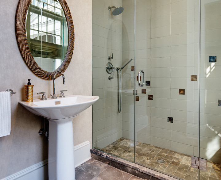 Clean lines and neutral colors create serenity in this bathroom. Hand-selected agate tiles, designed to look as though they were cascading down the wall, add interest while respecting the simplicity of the space. Photo by Christopher Wesnofske