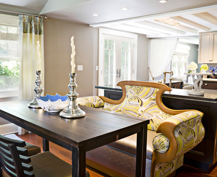 The whimsical, custom–designed banquette is the centerpiece of this funky Hamptons cottage, but this grand design is also practical: the specially treated fabric can be wiped clean and the adjoining dining table, made of recycled wood floors, is on a rolling stainless steel base for easy in and out. Photo by Genevieve Garruppo