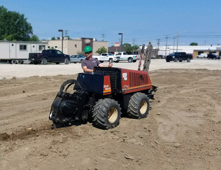 Ditch Witch with Trenching Blade