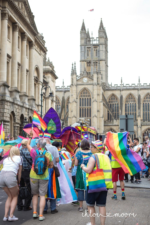 Bath Carnival 2018, pride, LGBT+ rainbow flag, Festival. Super Pirates, Bath abbey