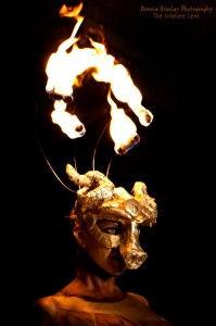 CirquedeVol.SaraPh.FiremaskGold.-199x300