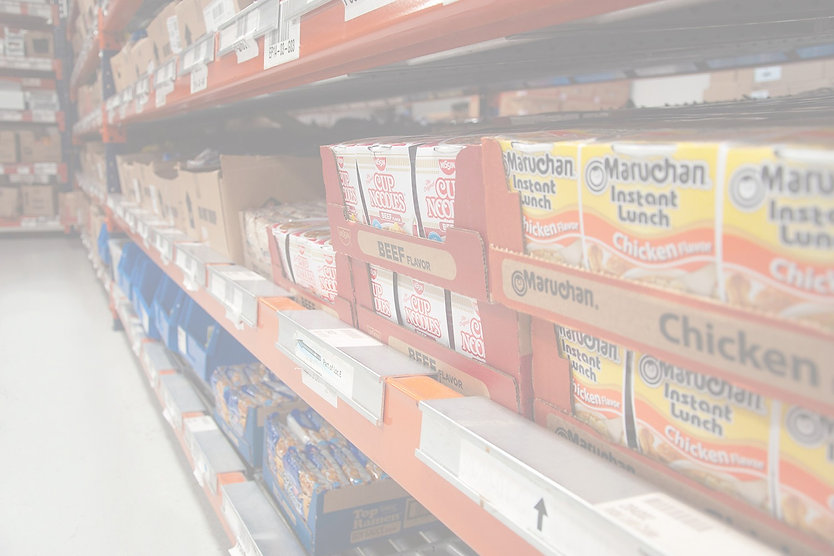 different kinds of ramen on a shelf in a warehouse