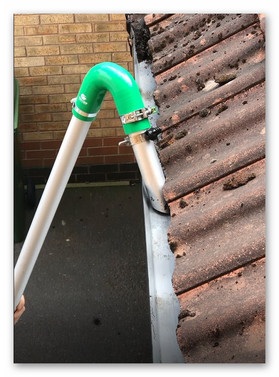 Gutter cleaning close-up in action