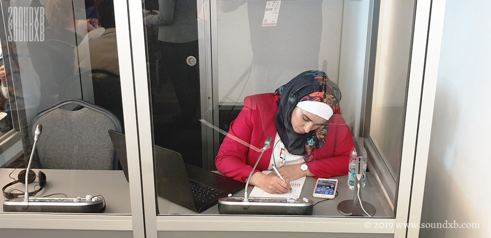 Arabic interpreter preparing in booth 10