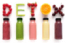 Detox word made with fruits from assorte