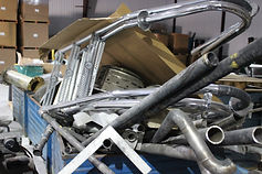 Aluminum doors and window frames that someone brought in for recycling.