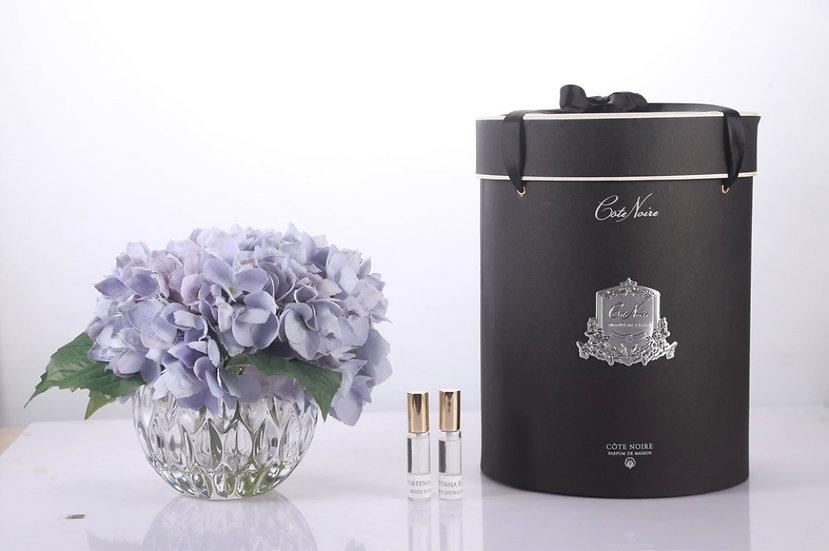 Cote Noire luxury hydrangeas blue in round crystal vase