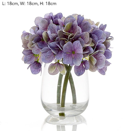 Blue Hydrangea in glass vase.