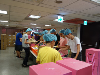 Community Service—Packing Mooncakes for Charity