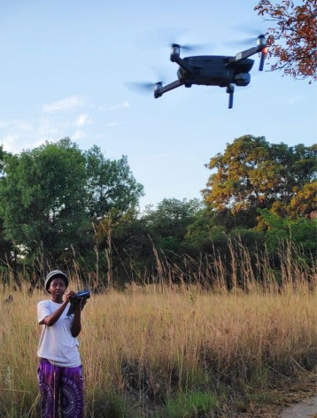 Dr Love Kaona flying the drone for aerial surveys of Kuti's wildlife