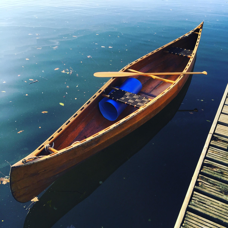 Autumn canoe on the lake