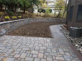 Back yard + Stone + Retaining wall + Stone work + Custom Stone + Custom Paver