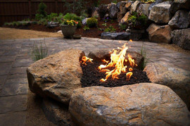 Stone fire place + Pavers + Custom + Sto