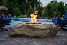 Stone fire place + Pool + Deck + Pavers + Custom + Stone
