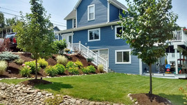 Deck + Stairs + Stone + Shrubs + lawn care + Trees + retaining wall