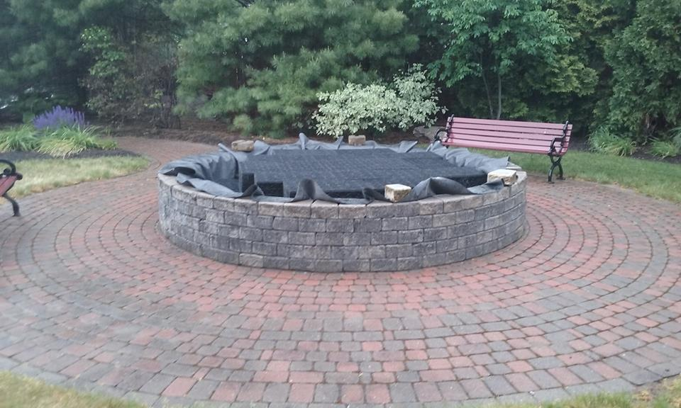 Stone fire place + Pavers + Custom + Stone Patio + fire place + Retaining wall + Corning + Elmira + Ithaca + Watkins Glen + Montour Falls + Geneva + Cayuga Lake + Snow and Ice Removal + Lawn Care + Custom Pattern + Patterned paver + Custom patio + Deck + Pool + Sidewalk + Driveway