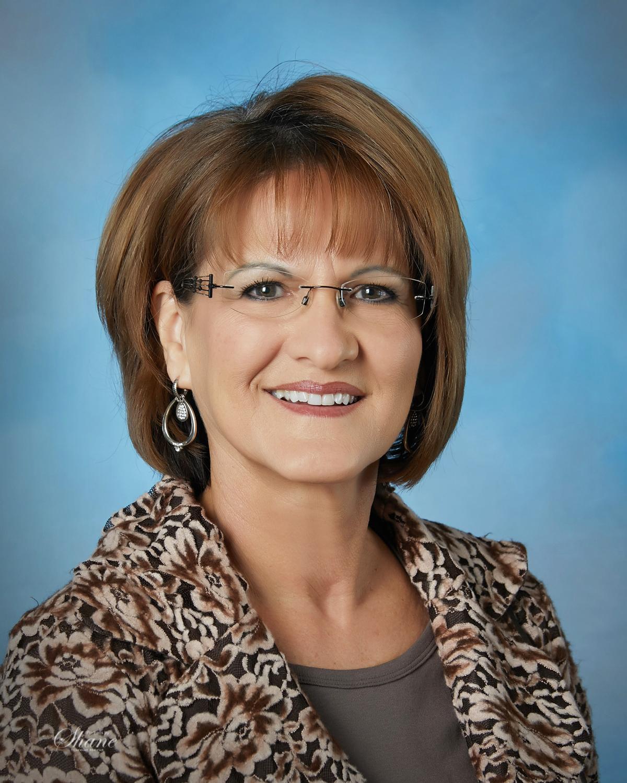 Glenna Achatz, Broker/Owner