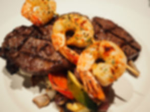 Sirloin steak and grilled shrimps on a w