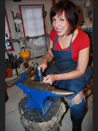 Dee tapping on her 100 year old anvil