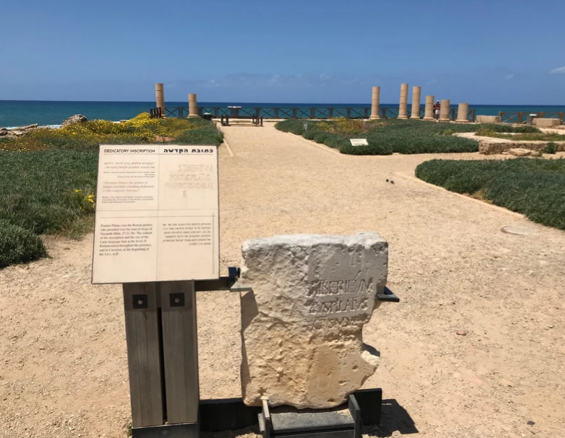 The Pilate Stone with the coastline at Caesarea behind it.