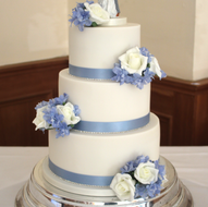 White and pale blue wedding cake