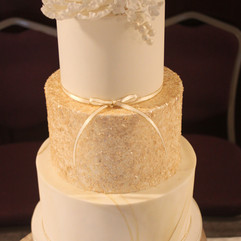 3 tier wedding cake with sugar flowers, gold glitter and marbled fondant