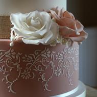 White and dusky pink wedding cake details