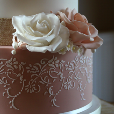 White and dusky pink wedding cake details
