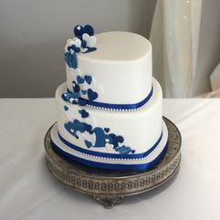 2 tier heart shaped wedding cake with royal blue fondant hearts