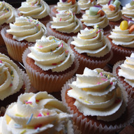 Vanilla cupcakes with buttercream swirl and sprinkles.