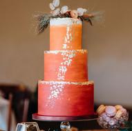 Burgundy, orange and gold wedding cake