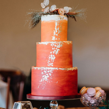 Burgundy, orange and gold wedding cake