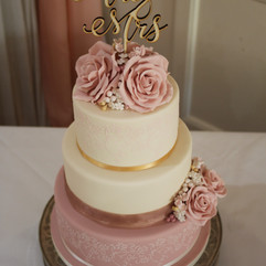 3 tier wedding cake with stencilled design, sugar roses and Mr & Mrs topper