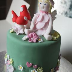 Fondant fairy and toadstools figures.