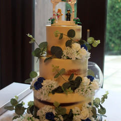 3 tier semi-naked wedding cake with artificial roses, gypsophelia & eucalyptus