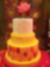 Red and yellow Moroccan tiles and mandala cake